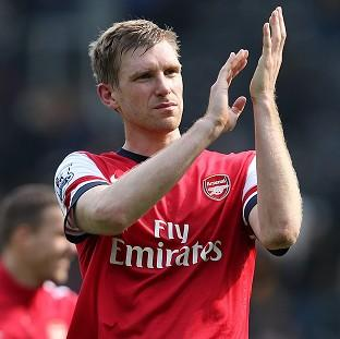 Per Mertesacker is determined to give Arsenal fans something to celebrate at Wembley