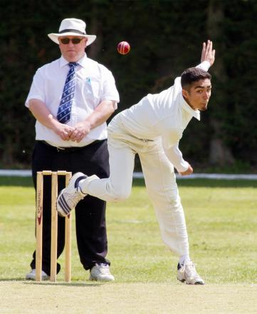 Egerton's Adil Valli bowling against Little Lever in Sunday's Hamer Cup tie