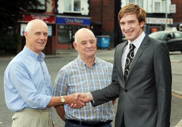 Liberal Democrat candidate Andrew Martin, right, with councillors Tony Radlett, left, and Roger Hayes