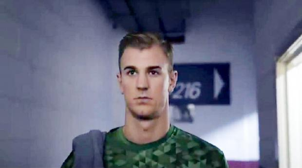 The Bolton News: With perfect hair, Joe Hart readies himself before the game