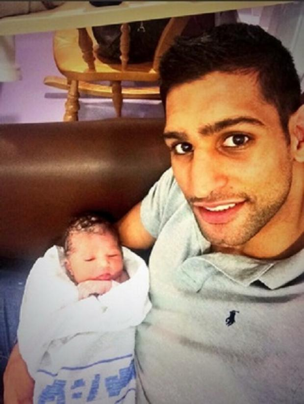The Bolton News: Amir Khan with his newborn baby Lamysa Khan. The boxer tweeted this picture today.