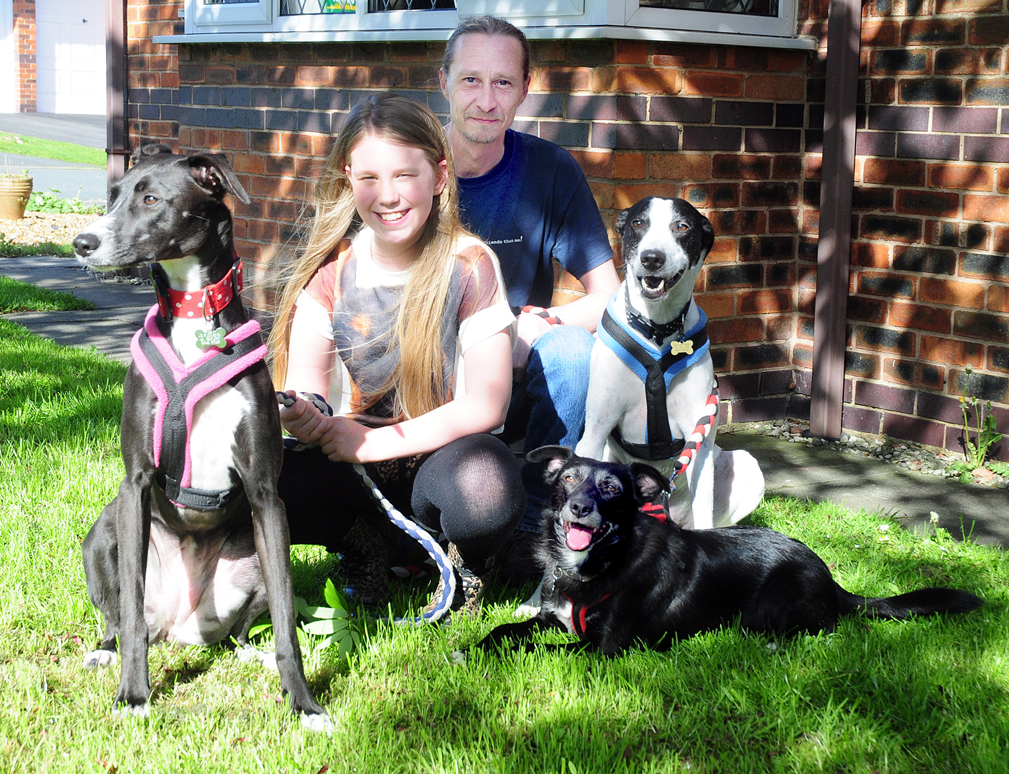 Scarlett Berry and dad Martin with their rescue dogs, from left, Mini, Mercy and Bentley