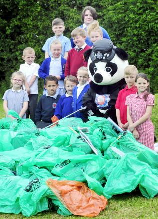 Pupils from Mytham Primary, St Matthew's, Masefield Primary, St Teresa's, St Stephen's and All Martyrs CE Primary with some of the rubbish collected at Bowness Community Primary, Little Lever