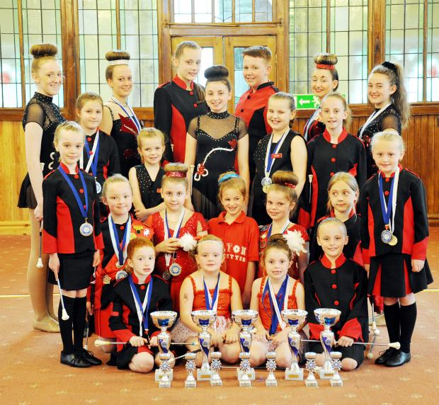 The Bolton Red Rose Majorettes with their medals and trophies