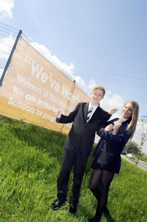 Pupils Callum Steele and Jess Phillips with the giant sign at St Catherine's Academy.