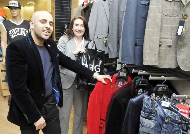 Mohamed Patel, of D3G clothing is welcomed to the Market Place by centre manager Nikki Wilson-Cook