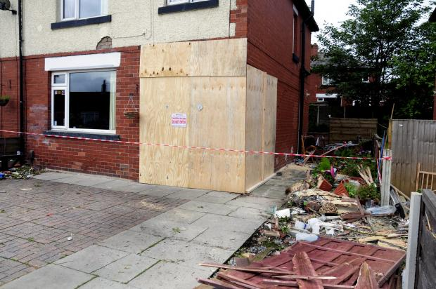 The Bolton News: The wrecked house in Harper Green Road, after a driver smashed a car into it and fled.