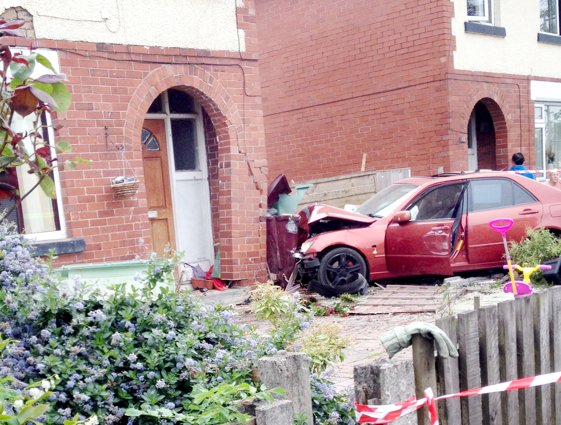 Family 'inches from death' as car ploughs into their house