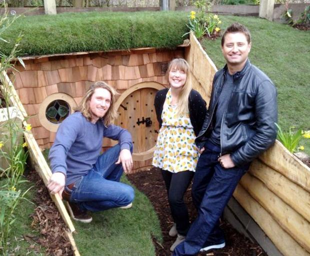 The Bolton News: Oliver and Tamsin Wotherspoon with George Clarke at the entrance to the magical 'Hobbit' house