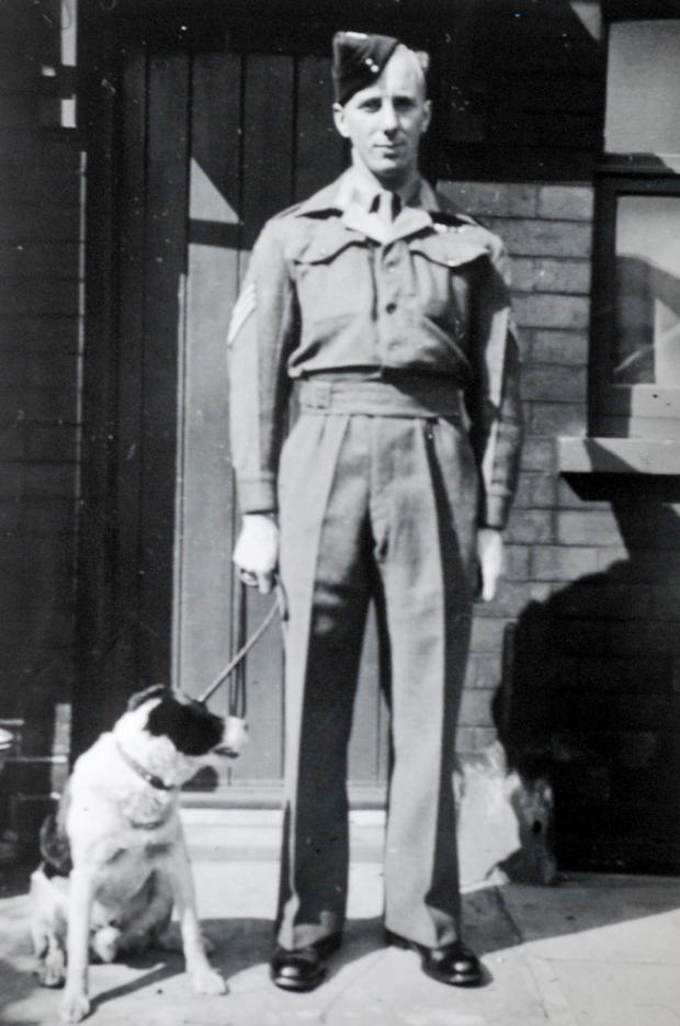 The Bolton News: Jim in wartime with a canine friend