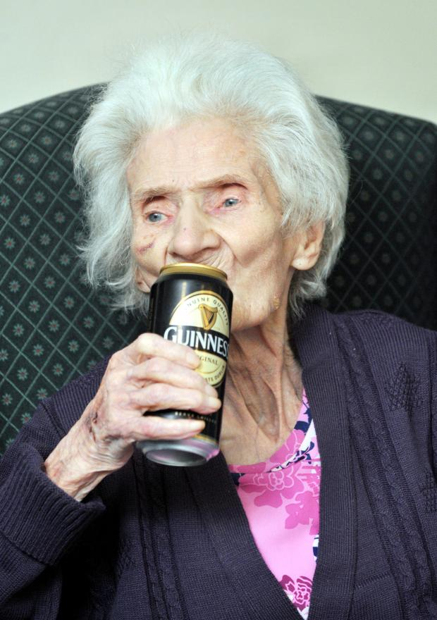 The Bolton News: Josephine Hulme toasts her 104th birthday with a can of her favourite drink