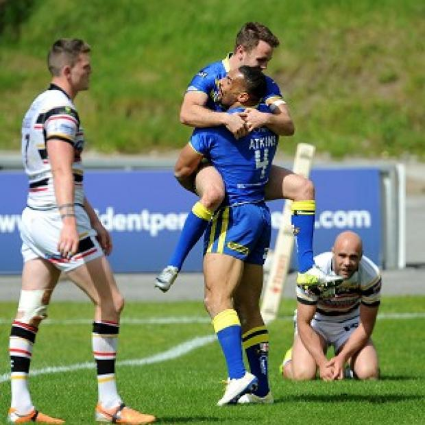 The Bolton News: Ryan Atkins celebrates with Richie Myler after scoring a try
