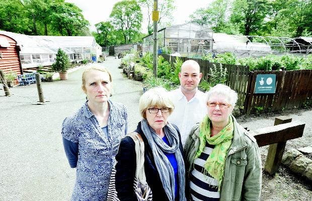 At the vandalised greenhouses are, from left, Souta Van Wick, Trisha Brindle, Richard Wallwork and Pat Smith.