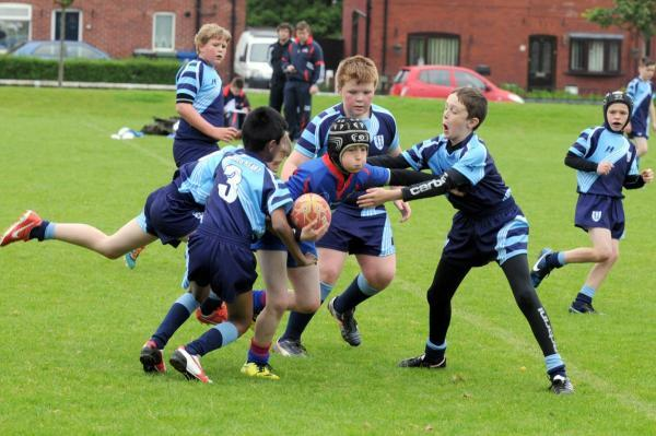 The Bolton News: Twelve Apostles take on Sacred Heart in the rugby tournament