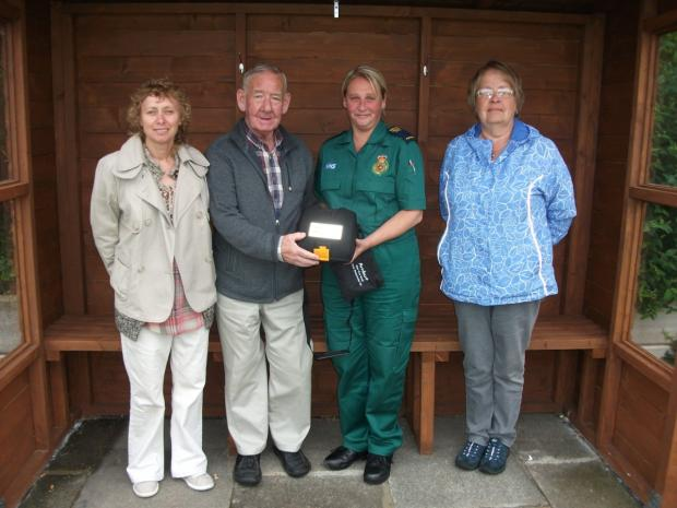 Clr Karen Aldred, chairman Robert Naylor, a representative for NWAS and secretary of the club Margaret Broom