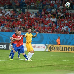 Tim Cahill, right, says Australia will learn from Chile defeat