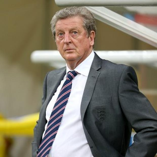 The Bolton News: England manager Roy Hodgson has sprung to the defence of Wayne Rooney after the 2-1 defeat to Italy