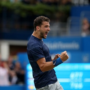 Grigor Dimitrov has claimed glory at the Queen's Club Aegon Championships