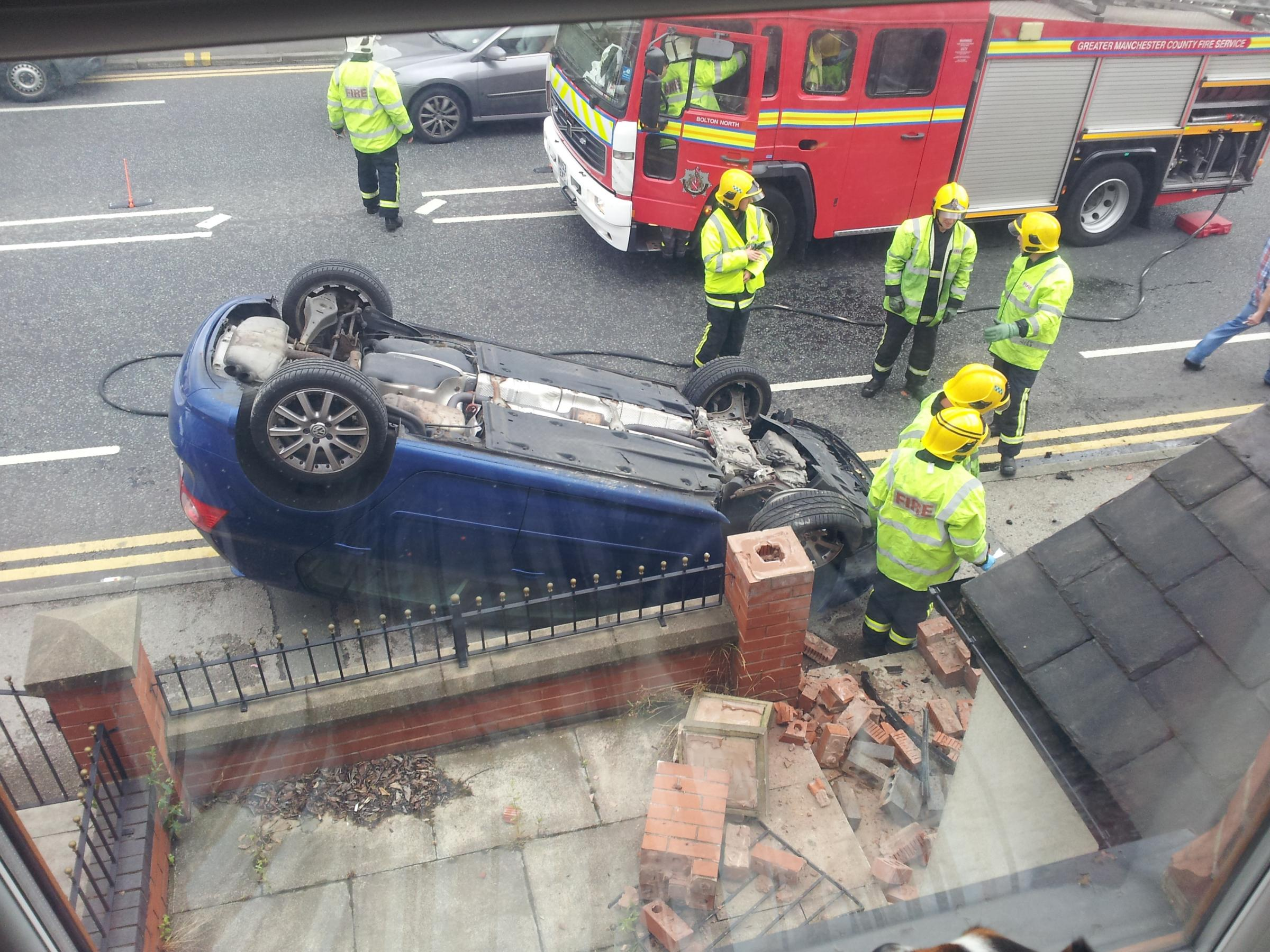 UPDATED: Driver smashes into three walls and flips car onto roof