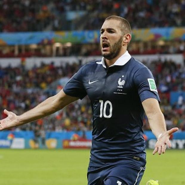 The Bolton News: Karim Benzema was involved in all three of France's goals (AP)