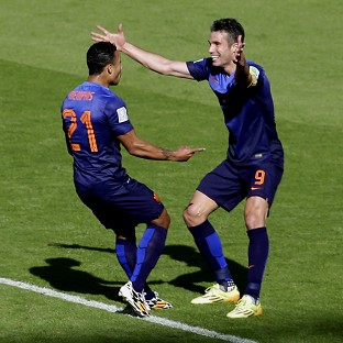 Memphis Depay, left, celebrates with Robin van Persie after scoring the winner against Australia (AP)