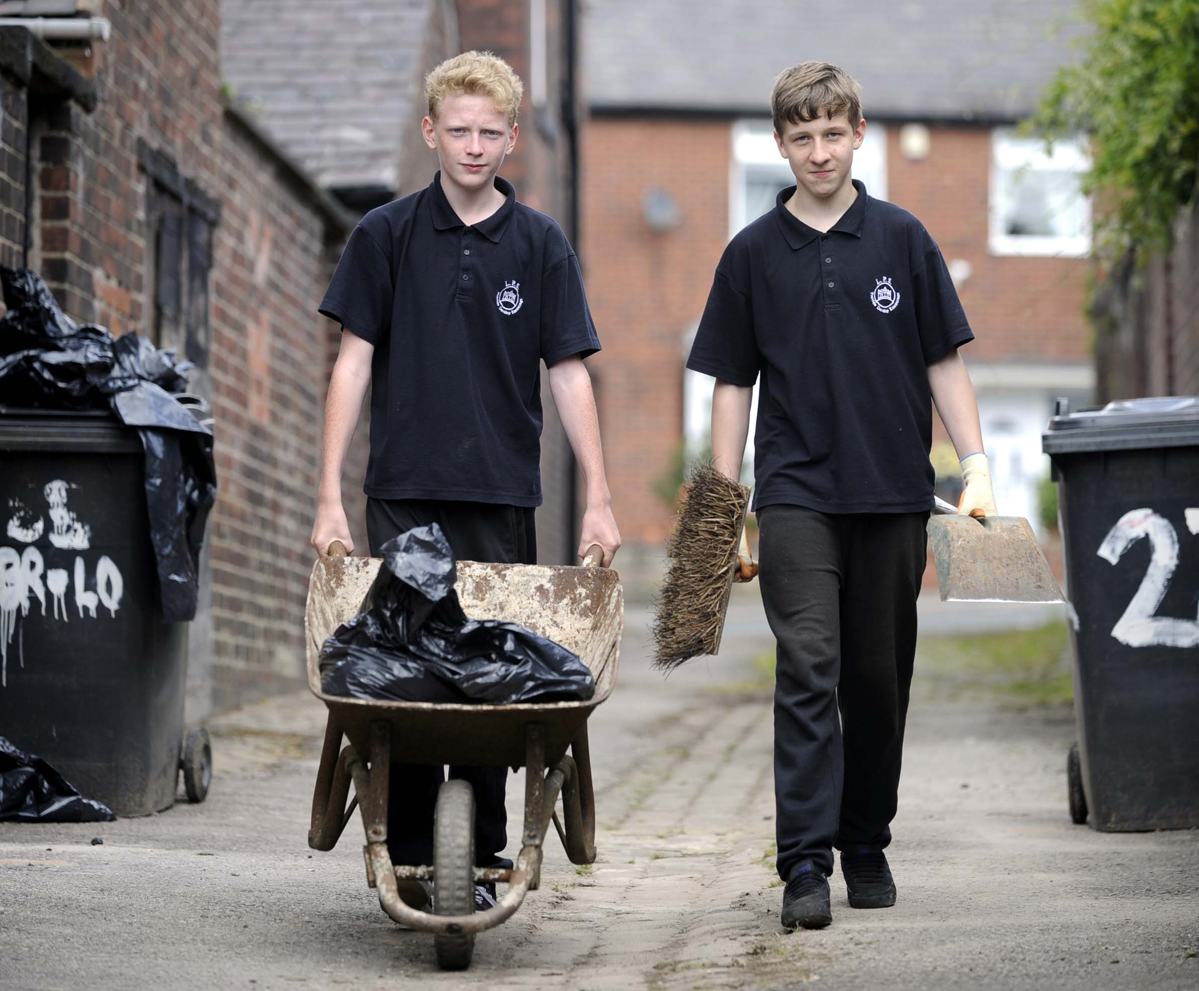 Youngsters clean up 'third world' back street in Horwich
