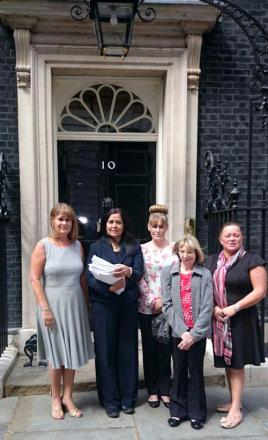 Yasmin Qureshi, second left, Nichola Williams, centre and fellow campaigners outside 10 Downing Street