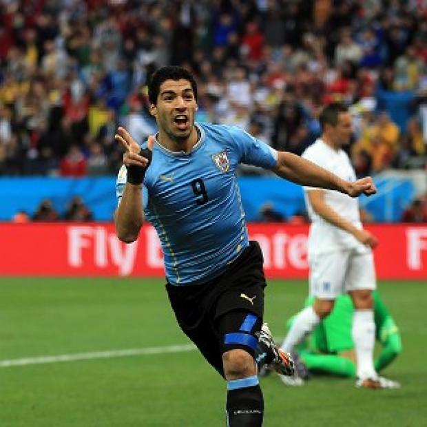 The Bolton News: Luis Suarez scored twice against England