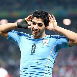 Luis Suarez scored both of Uruguay's goals against England