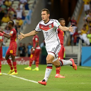 Miroslav Klose rescued a point 20 minutes from time for Germany