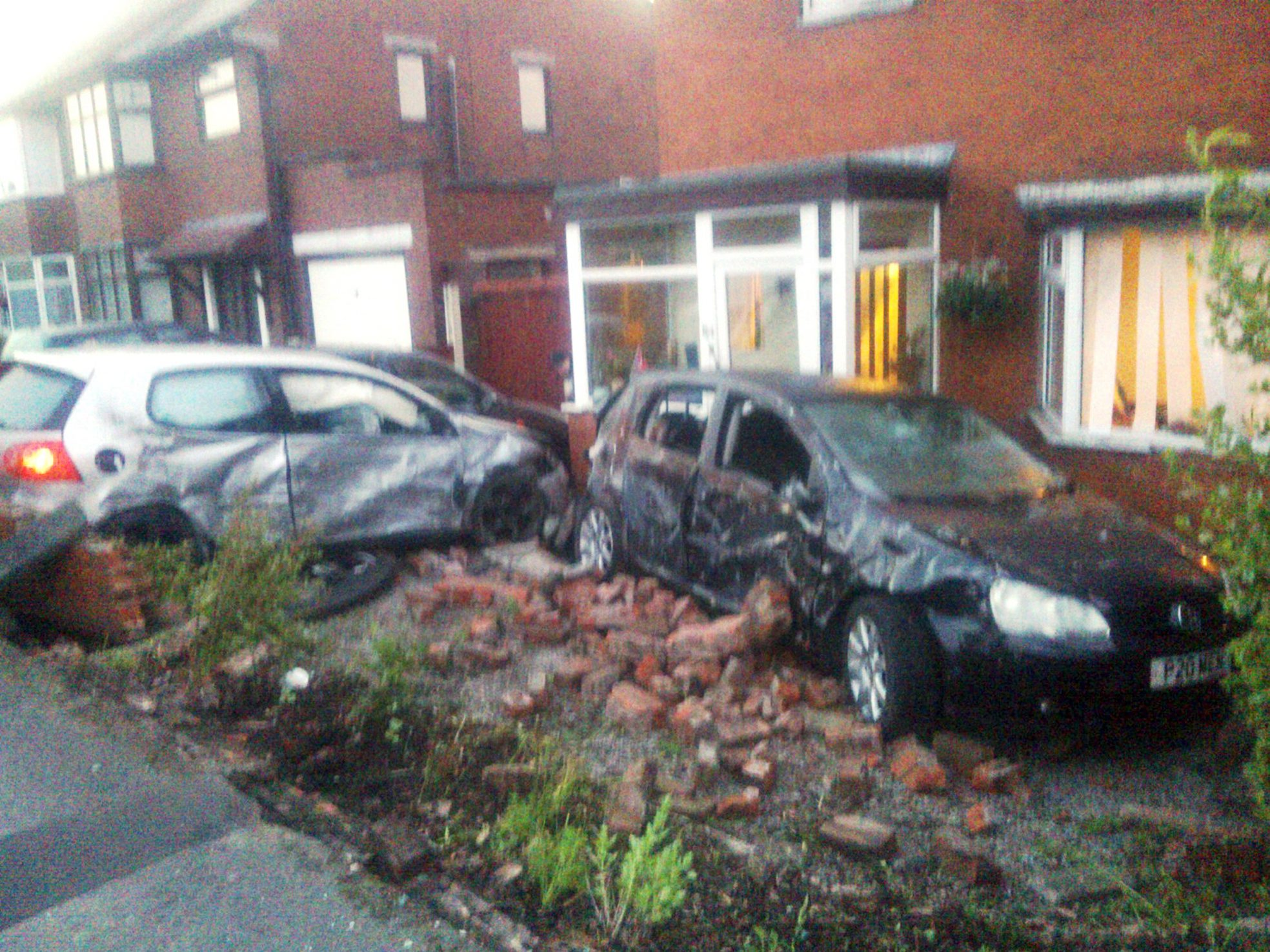 UPDATED: Police hunting three people after car crashes into garden wall in Little Lever