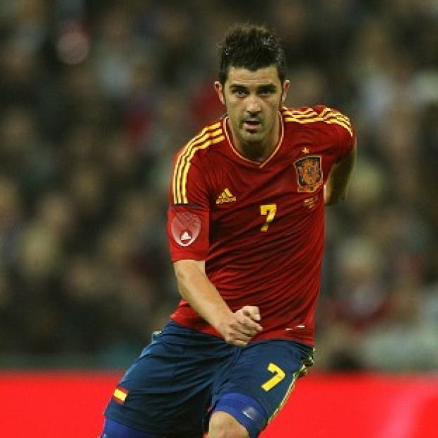 The Bolton News: Spain striker David Villa signed off his international career with his 59th goal in 97 games in the 3-0 World Cup victory over Australia