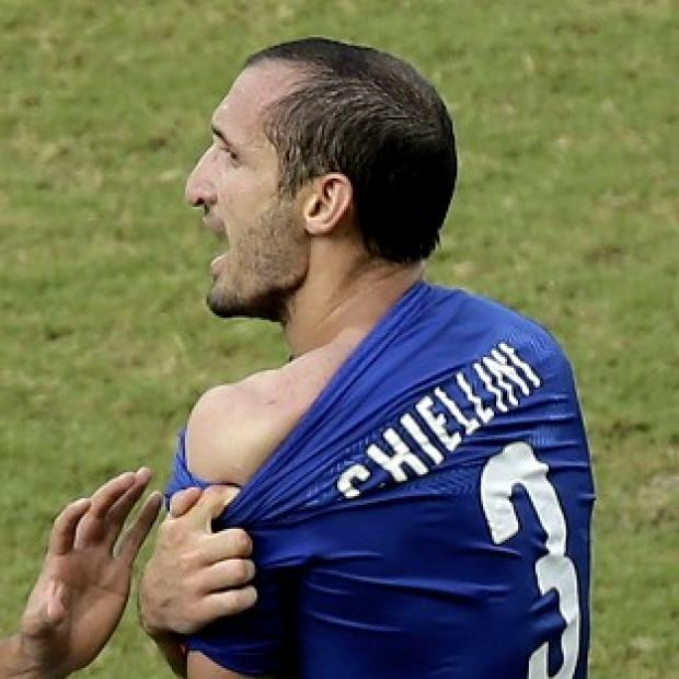 The Bolton News: Giorgio Chiellini claims he was bitten by Luis Suarez (AP)