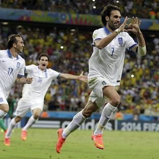 Giorgos Samaras celebrates scoring Greece's last-gasp winner (AP)