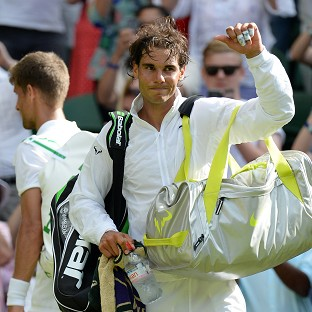 Rafael Nadal, pictured, will never miss Wimbledon to ease the burden on his troublesome knees, according to coach Toni Nadal