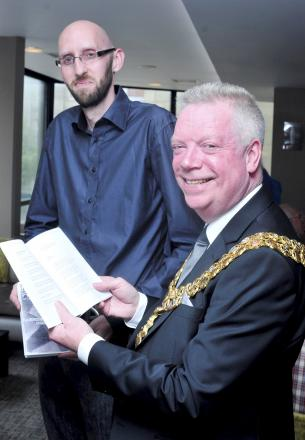 Organiser Scott Devon greets the Mayor of Bolton, Cllr Martin Donaghy, at the poetry festival at the Octagon Theatre