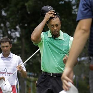 The Bolton News: Tiger Woods showed signs of rustiness on his return to action after back surgery (AP)
