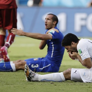 "Suarez claims he ""lost his balance"""