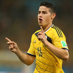 James Rodriguez scored twice to send Colombia through
