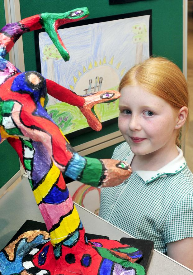The Bolton News: Daisy Vose, aged eight, with one of the sculptures.