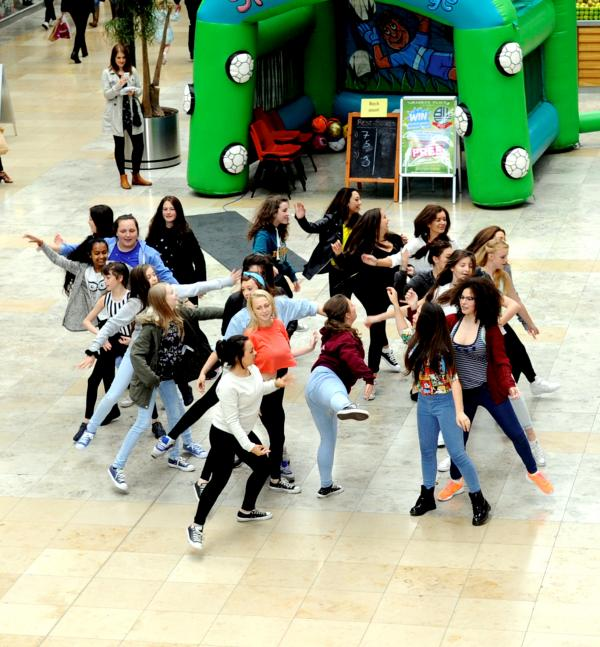 The flash mob perform in the Market Place to raise awareness of Farnworth Literacy Festival