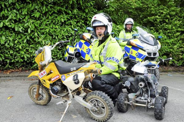 PC Jeff Wadey, front, and PC Martin Trudgett run the rule over suspect off road bikes