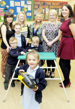 Sienna Cubbins and the defibrillator, with from left, Jenson Carr, aged six, Aston Carr, aged 10, and Jay Cubbins, aged seven. Back from left are Jess Carr, Alison Baron, Jane Kay, headteacher, Michelle Walton, TASMA and Tracey Wilkinson
