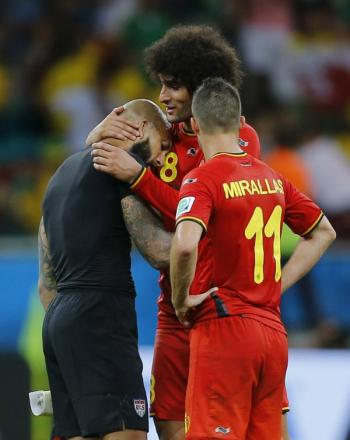 Tim Howard is consoled by Marouane Fellaini and Kevin Mirallas following his heroic display in the USA's second-round defeat to Belgium