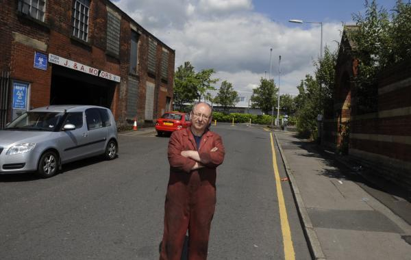 Owner Adam Czutkowna outside J & A Motors in Clarence Street, Bolton