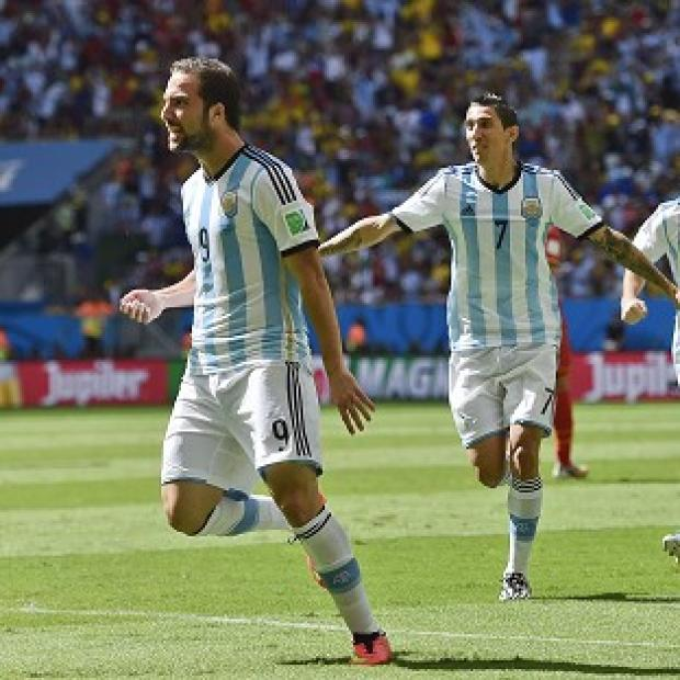 The Bolton News: Argentina's Gonzalo Higuain, left, celebrates scoring the winner (AP)