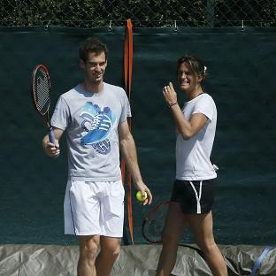 Andy Murray, left, is weighing up whether to keep on Amelie Mauresmo