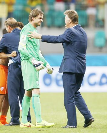 Netherlands keeper Tim Krul is congratulated by coach Louis Van Gaal after his penalty shootout heroics on Saturday
