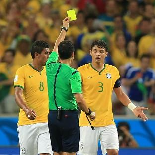Thiago Silva, right, received a yellow card during Brazil's win over Colombia