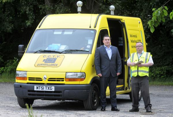 Environmental education and enforcement manager Andy Bolan and enforcement officer Alan Jones by one of the yellow vans